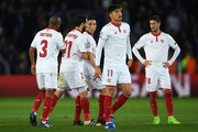Samir Nasri of Sevilla is shepherded off the pitch by teammates after he was shown the red card during the UEFA Champions League Round of 16, second leg match between Leicester City and Sevilla FC at The King Power Stadium on March 14, 2017 in Leicester, United Kingdom.
