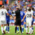 Mike Dean Photos - Match Referee, Mike Dean shows Jamie Vardy of Leicester City a red card during the Premier League match between Leicester City and Wolverhampton Wanderers at The King Power Stadium on August 18, 2018 in Leicester, United Kingdom. - Leicester City vs. Wolverhampton Wanderers - Premier League