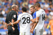 Referee Mike Dean speaks to Jamie Vardy of Leicester before sending him off during the Premier League match between Leicester City and Wolverhampton Wanderers at The King Power Stadium on August 18, 2018 in Leicester, United Kingdom.
