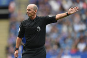 Referee Mike Dean gestures during the Premier League match between Leicester City and Wolverhampton Wanderers at The King Power Stadium on August 18, 2018 in Leicester, United Kingdom.