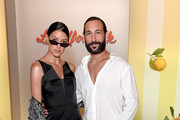 Rebecca Mir and Massimo Sinato attend the Lena Hoschek show during the Berlin Fashion Week Spring/Summer 2019 at ewerk on July 3, 2018 in Berlin, Germany.