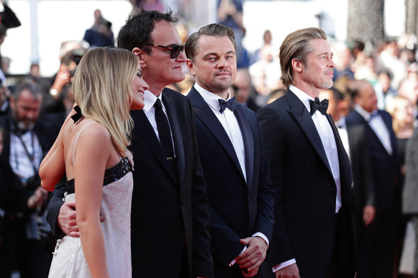'Once Upon A Time In Hollywood' Red Carpet - The 72nd Annual Cannes Film Festival [suit,event,premiere,formal wear,fashion,dress,white-collar worker,tuxedo,red carpet,flooring,brad pitt,quentin tarantino,leonardo dicaprio,margot robbie,once upon a time in hollywood,l-r,red carpet,screening,the 72nd annual cannes film festival,cannes film festival]