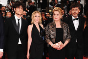 """(L-R) Louis Garrel, Chiara Mastroianni, Catherine Deneuve and director Christophe Honore attends the """"Les Bien-Aimes"""" premiere at the Palais des Festivals during the 64th Cannes Film Festival on May 22, 2011 in Cannes, France."""