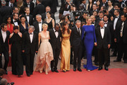 "(L-R) Jury Members Jude Law, Nansun Shi, Jury President Robert De Niro, Linn Ullmann, Mahamat-Saleh Haroun, Martina Gusman, Olivier Assayas,  Uma Thurman, and Johnnie To attend the ""Les Bien-Aimes"" premiere at the Palais des Festivals during the 64th Cannes Film Festival on May 22, 2011 in Cannes, France."
