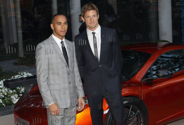 Lewis Hamilton Jenson Button (R) and Lewis Hamilton attend the McLaren London showroom opening at One Hyde Park on June 21, 2011 in London, England.