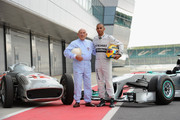 Sir Stirling Moss and Mercedes AMG Petronas F1 driver Lewis Hamilton meet at Silverstone Circuit on May 31, 2013 in Northampton, England.