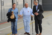 Sir Stirling Moss, wife Suzie and Tony Jardine arrive at Silverstone Circuit on May 31, 2013 in Northampton, England.