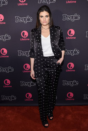 Idina Menzel looked relaxed yet smart in a printed black satin pantsuit at the New York screening of 'Beaches.'