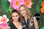 Alyssa Milano and Kim Raver attend the Lifetime Summer Luau on May 20, 2019 in Los Angeles, California.