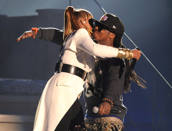 Lil Wayne Singer Mary J. Blige (L) and rapper Lil Wayne perform onstage during the 2011 Billboard Music Awards at the MGM Grand Garden Arena May 22, 2011 in Las Vegas, Nevada.