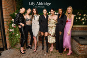 (L-R) Romee Strijd, Stella Maxwell, Taylor Hill, Elsa Hosk, Lily Aldridge, Jasmine Tookes and Martha Hunt pose for a photo during the Lily Aldridge parfums launch event at The Bowery Terrace at the Bowery Hotel on September 08, 2019 in New York City.