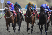 Paul Hanagan riding Ertijaal (R) win The 32Red Spring Cup at Lingfield racecourse on March 22, 2014 in Lingfield, England.