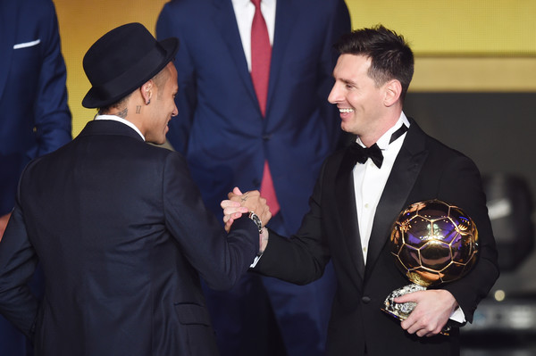 FIFA Ballon d'Or Gala 2015 [suit,formal wear,event,tuxedo,businessperson,gesture,white-collar worker,official,ceremony,fashion accessory,lionel messi,winner,neymar jr,dor,fc barcelona,argentina,ballon,brazil,fifa ballon dor,gala]