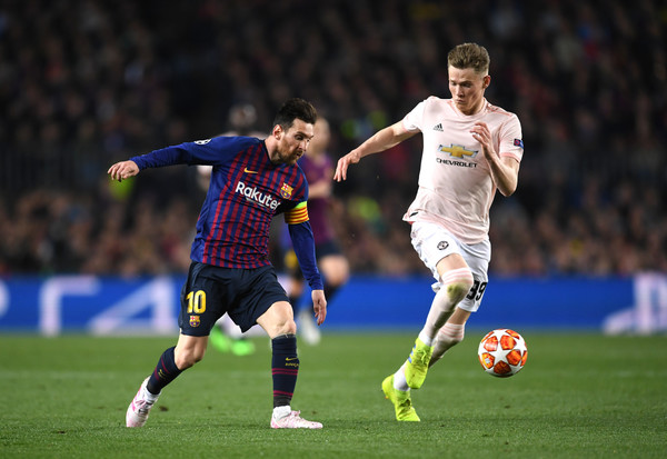 Lionel Messi and Scott McTominay Photos - 1 of 8