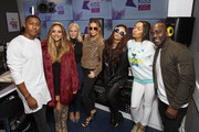 Little Mix pose with KISS Breakfast presenters Rickie Haywood Williams, Charlie Hedges and Melvin O'Doom during their visit to the Kiss FM Studio's on September 24, 2015 in London, England.