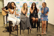 """Leigh-Anne Pinnock, Perrie Edwards, Jesy Nelson and Jade Thirlwall of Little Mix perform on """"The Elvis Duran Z100 Morning Show"""" at Z100 Studio on August 20, 2015 in New York City."""