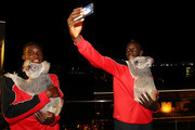 Liverpool FC players Mamadou Sakho and Sheyi Ojo cuddle Australia Zoo koalas Mackenzie and India at Gambaro Hotel on July 16, 2015 in Brisbane, Australia. Liverpool FC are in Queensland to play the Brisbane Roar at Suncorp Stadium on the first leg of their Australian tour