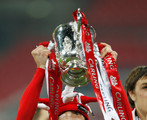 Maxi Rodriguez of Liverpool celebrates with the trophy after victory in the Carling Cup Final match between Liverpool and Cardiff City at Wembley Stadium on February 26, 2012 in London, England. Liverpool won 3-2 on penalties.
