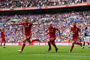 (L-R) Andy Carroll of Liverpool celebrates with Martin Skrtel and Maxi Rodriguez as he scores their second goal during the FA Cup with Budweiser Semi Final match between Liverpool and Everton at Wembley Stadium on April 14, 2012 in London, England.