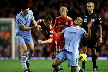 Vincent Kompany Charlie Adam Liverpool v Manchester City - Premier League
