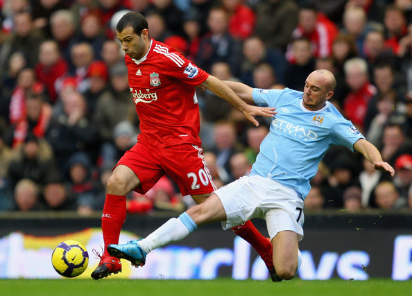 Javier Mascherano of Liverpool is tackled by Stephen Ireland of Manchester City during the Barclays Premier League match between Liverpool and Manchester City at Anfield on November 21, 2009 in Liverpool, England.