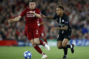 Neymar of Paris Saint-Germain battles for possession with James Milner of Liverpool during the Group C match of the UEFA Champions League between Liverpool and Paris Saint-Germain at Anfield on September 18, 2018 in Liverpool, United Kingdom.