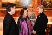 Sophie, Countess of Wessex talks with (left to right) Christopher Kane, Suzy Menkes, and Felicity Hayward as she hosts a reception to celebrate 10 years of the London College of Fashion's Better Lives project at Buckingham Palace on November 28, 2018 in London, England.