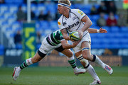 Andy Powell of Sale is tackled during the LV= Cup match between London Irish and Sale Sharks at Madejski Stadium on November 11, 2012 in Reading, England.