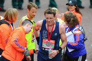 James Cracknell poses at the finish line during The London Marathon 2015 on April 26, 2015 in London, England.