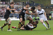 Henry Fa'afili of Leeds is tackled by Riki Flutey and Elliot Daly (R) during the Aviva Premiership match between London Wasps and Leeds Carnegie at Adams Park on April 17, 2011 in High Wycombe, England.