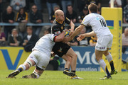 Joe Simpson of Wasps is tackled by Hendre Fourie and Adrian Jarvis (R) during the Aviva Premiership match between London Wasps and Leeds Carnegie at Adams Park on April 17, 2011 in High Wycombe, England.