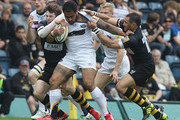 Henry Fa'afili of Leeds is tackled by Elliot Daly (L) and Riki Flutey during the Aviva Premiership match between London Wasps and Leeds Carnegie at Adams Park on April 17, 2011 in High Wycombe, England.