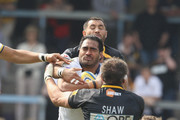 Henry Fa'afili of Leeds is tackled by Simon Shaw and Riki Flutey during the Aviva Premiership match between London Wasps and Leeds Carnegie at Adams Park on April 17, 2011 in High Wycombe, England.