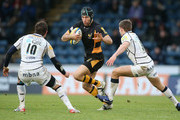 Chris Bell of Wasps takes on Nick MacLeod (L) and Will Cliff during the Aviva Premiership match between London Wasps and Sale Sharks at Adams Park on December 23, 2012 in High Wycombe, England.