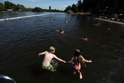 Brother and sister Olek, 10, and Kasia, 8, jump into the Serpentine Lido on August 19, 2009 in London, England. The Met office predicted one of the hottest days of the year so far, with temperatures in London and the South East expected to hit 30C.