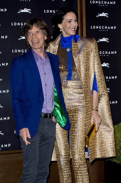 (L-R) L'Wren Scott and Mick Jagger attend the grand opening party of Longchamp Regent Street on September 14, 2013 in London, England.