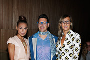 Toni Trucks, Eric Andrew and Nikki Poulos attend the Loris Diran fashion show during Mercedes-Benz Fashion Week at the DiMenna Center on September 12, 2013 in New York City.