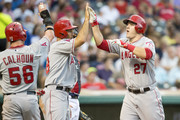 Kole Calhoun #56 and Raul Ibanez #28 celebrate with Mike Trout #27 of the Los Angeles Angels of Anaheim after Trout hit a three run home run during the fifth inning against the Cleveland Indians at Progressive Field on June 17, 2014 in Cleveland, Ohio.