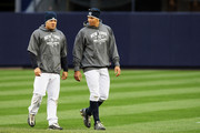 (L-R) Melky Cabrera #53 and Alex Rodriguez #13 of the New York Yankees talk during warms ups before playing against of the Los Angeles Angels of Anaheim in Game One of the ALCS during the 2009 MLB Playoffs at Yankee Stadium on October 16, 2009 in New York, New York.