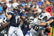 Quarterback Philip Rivers #17 of the Los Angeles Chargers goes back for a pass in the pocket during the first quarter of the game against the Los Angeles Rams at Los Angeles Memorial Coliseum on September 23, 2018 in Los Angeles, California.