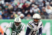 Keenan Allen #13 of the Los Angeles Chargers is pursued by Morris Claiborne #21 of the New York Jets during the second half of an NFL game at MetLife Stadium on December 24, 2017 in East Rutherford, New Jersey.