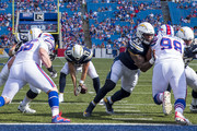 Philip Rivers #17 of the Los Angeles Chargers fumbles a snap during the fourth quarter against the Buffalo Bills at New Era Field on September 16, 2018 in Orchard Park, New York. Los Angeles defeats Buffalo 31-20.