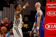 John Collins #20 of the Atlanta Hawks reacts after dunking against Marcin Gortat #13 of the LA Clippers at State Farm Arena on November 19, 2018 in Atlanta, Georgia.  NOTE TO USER: User expressly acknowledges and agrees that, by downloading and or using this photograph, User is consenting to the terms and conditions of the Getty Images License Agreement.