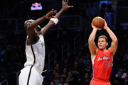 Blake Griffin #32 of the Los Angeles Clippers takes a shot with pressure from Kevin Garnett #2 of the Brooklyn Nets during the first quarter at Barclays Center on December 12, 2013 in the Brooklyn borough of New York City. NOTE TO USER: User expressly acknowledges and agrees that, by downloading and/or using this photograph, user is consenting to the terms and conditions of the Getty Images License Agreement.