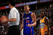 Blake Griffin #32 of the Los Angeles Clippers questions a call with referee Zach Zarba #28 as Kenneth Faried #35 of the Denver Nuggets looks on at Pepsi Center on December 19, 2014 in Denver, Colorado. The Nuggets defeated the Clippers 109-106. NOTE TO USER: User expressly acknowledges and agrees that, by downloading and or using this photograph, User is consenting to the terms and conditions of the Getty Images License Agreement.