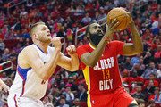 James Harden #13 of the Houston Rockets drives with the basketball against Cole Aldrich #45 of the Los Angeles Clippers during their game at the Toyota Center on March 16, 2016 in Houston, Texas.  NOTE TO USER: User expressly acknowledges and agrees that, by downloading and or using this Photograph, user is consenting to the terms and conditions of the Getty Images License Agreement.