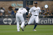 Ryan Braun #8 of the Milwaukee Brewers fails to catch a fly ball next to Keon Broxton #23 in the second inning against the Los Angeles Dodgers at Miller Park on July 22, 2018 in Milwaukee, Wisconsin.