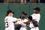 Travis Snider #23, Andrew McCutchen #2  and Gregory Polanco #25 of the Pittsburgh Pirates celebrate after defeating the Los Angeles Dodgers 6-1 at PNC Park July 23, 2014 in Pittsburgh, Pennsylvania.