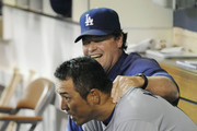 Hiroki Kuroda #18 of the Los Angeles Dodgers is congratulated by pitching coach Rick Honeycutt after Kuroda came out of the game in the seventh inning of  a baseball game against the San Diego Padres at Petco Park on August 2, 2011 in San Diego, California. The Dodgers won 1-0.