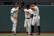 (L-R) Angel Pagan #16, Denard Span #2 and Hunter Pence #8 of the San Francisco Giants celebrates defeating the Los Angeles Dodgers 9-6 at AT&T Park on April 10, 2016 in San Francisco, California.